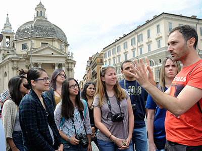 Professor speaks to students traveling in Rome