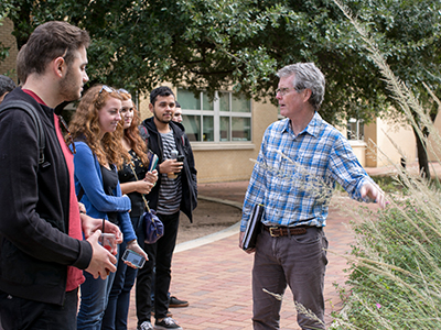 Professor Bill Quinn with St. Edward's students in outdoor classroom