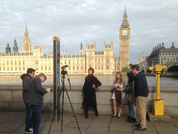 Chris Flynn and students filming on Westminister Bridge, London