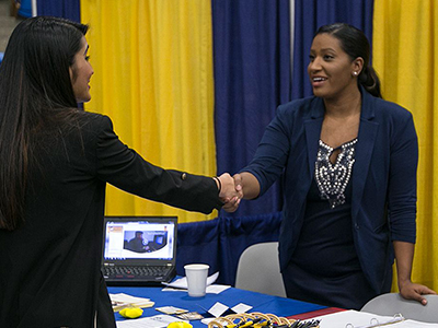 A student shaking hands at the Job Fair