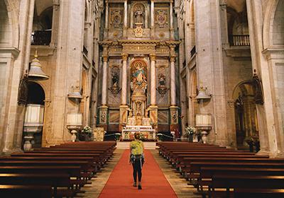 Hannah Thornby inside the Church in the El Camino de Santiago