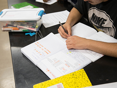 High school student reading in his desk image