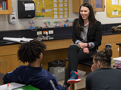 Angie Lux talking with students