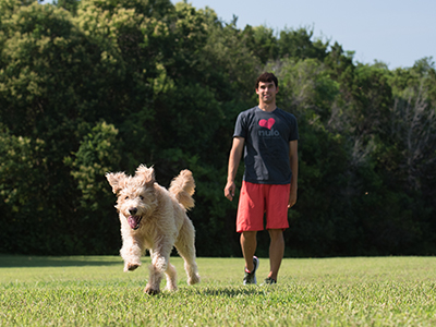 Ricky Berens playing with dog