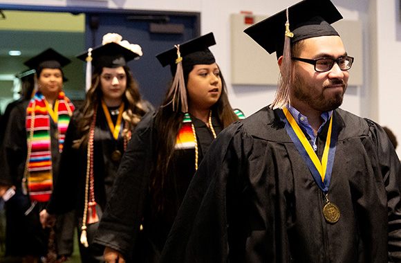St. Edward's Latinx students in their graduation caps, gowns and stoles