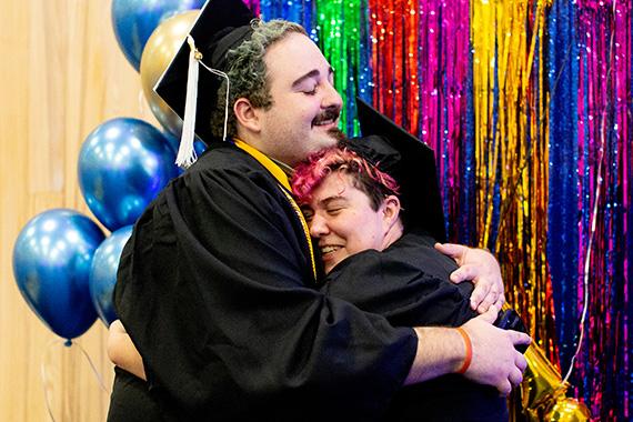 St. Edward's students share a hug at LGBTQ Lavendar Graduation