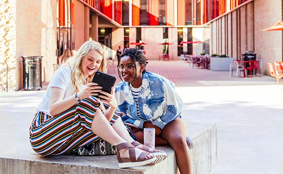Students hangout in residence hall courtyard