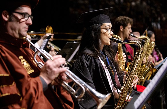 St. Edward's jazz band plays as students enter the commencement hall