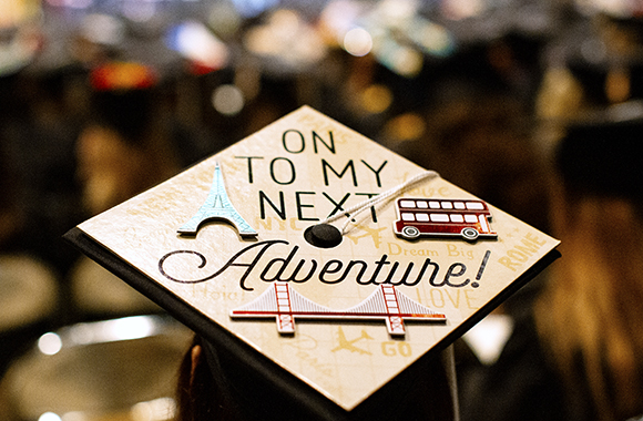 "Graduation cap with ""On to My Next Adventure"" lettering"