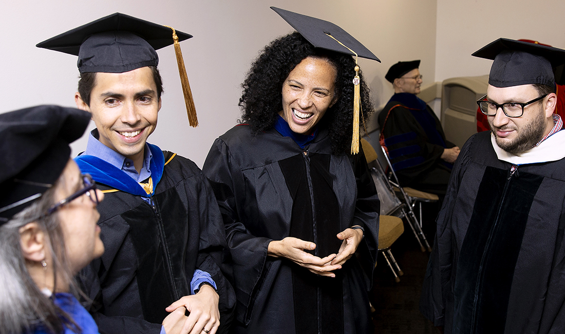 St. Edward's facutly members visit backstage prior to the 2019 St. Edward's Commencement Ceremony