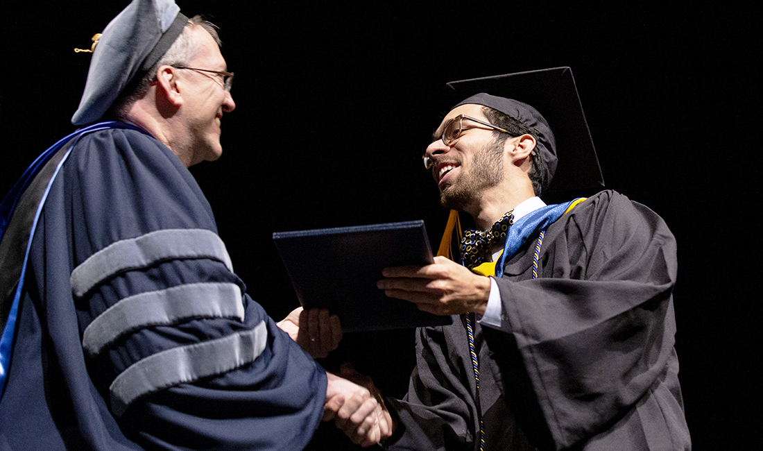 St. Edward's graduate receives his dipolma at 2019 Commencement Ceremony