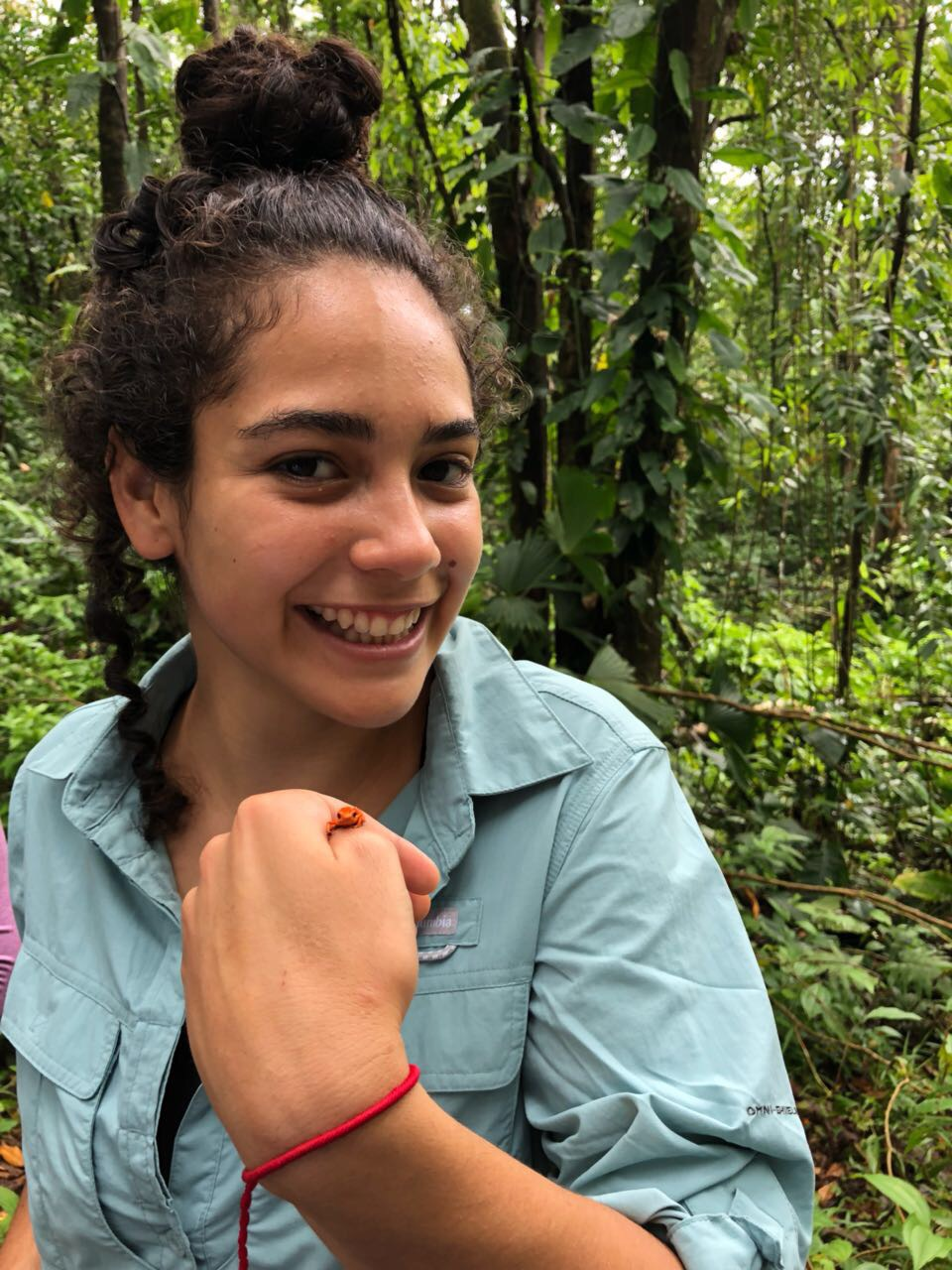 Camila Rojas in Costa Rica with a tree frog