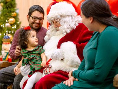 Family with santa at holiday mingle