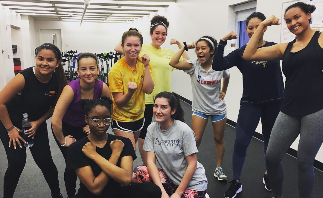 Students in fitness class pose for group photo