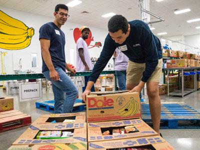 Students volunteering at Capital Food Bank