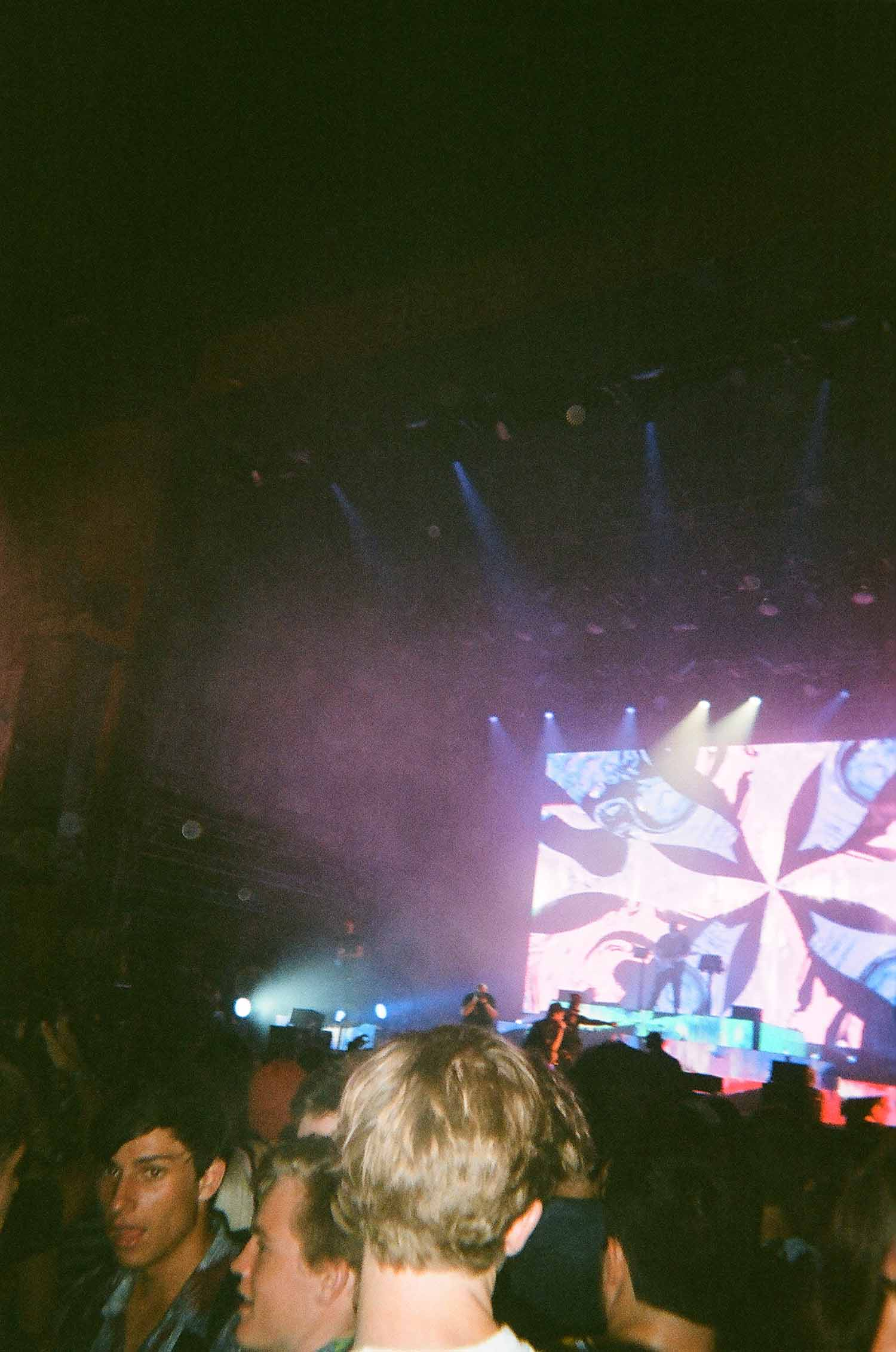 Musicians performing on a stage at ACL at night.