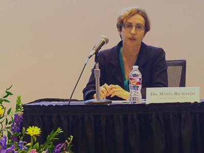 Dr. Marie Richards speaking at Kozmetsky conference