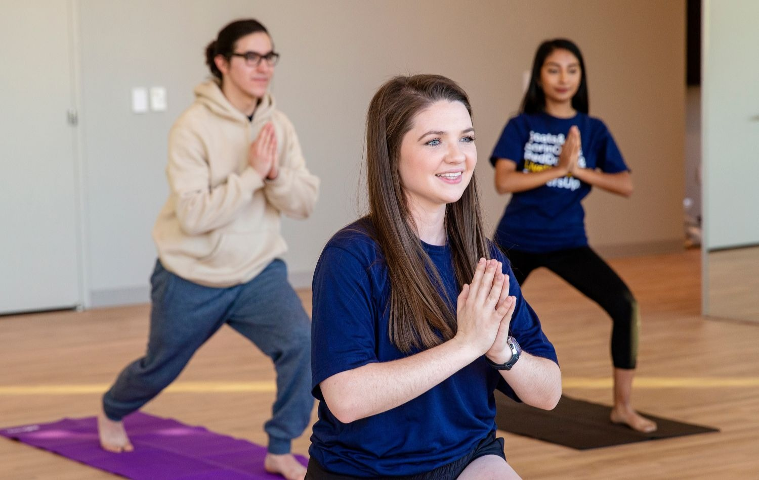 Students at St. Edward's relax with yoga
