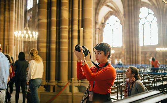 Student taking a photograph in a church