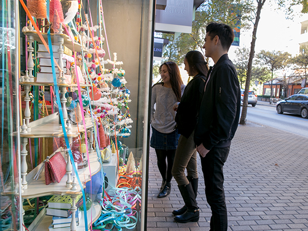 St. Edward's students looking at 2nd St. holiday displays