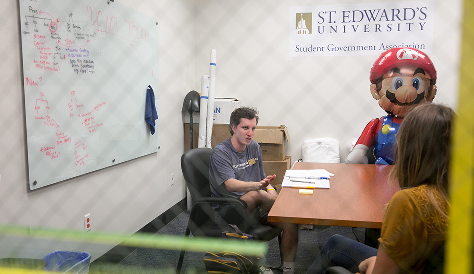Ben Griffith and students in the Student Government Association meet in their office inside Student Life.