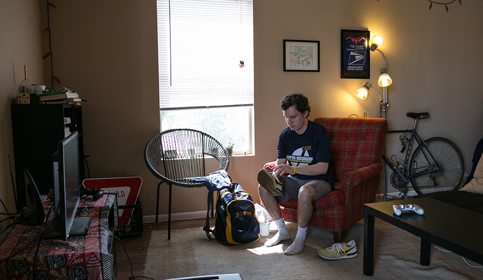 In his off-campus apartment, Ben Griffith packs items he'll need for his Orientation and Campus Recreation shifts.