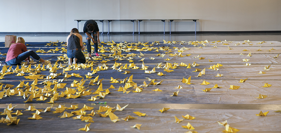 Students assembling butterfly installation
