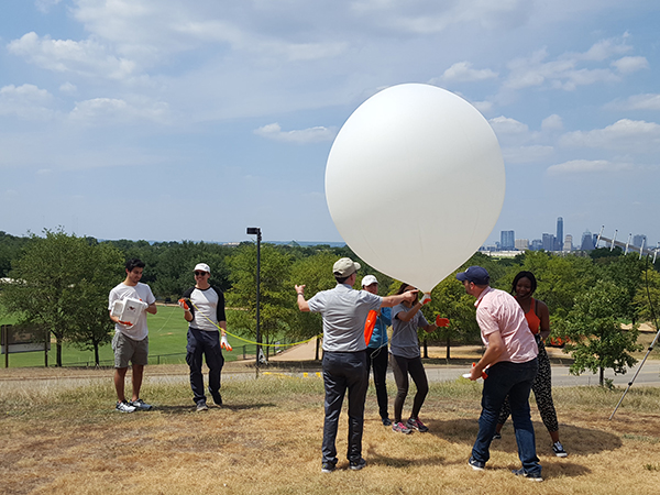 Students & professors launch weather balloon on campus
