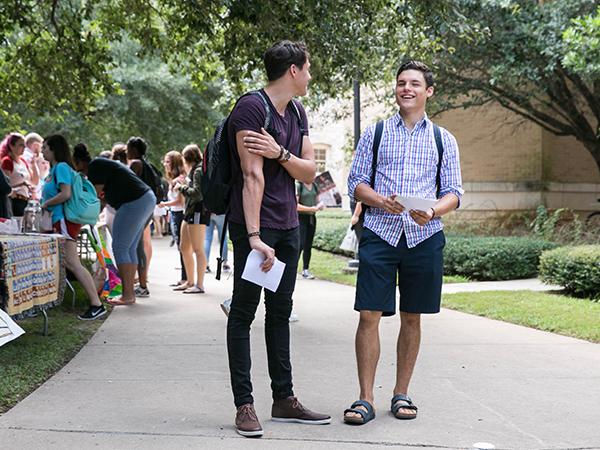 Students walking around involvement fair