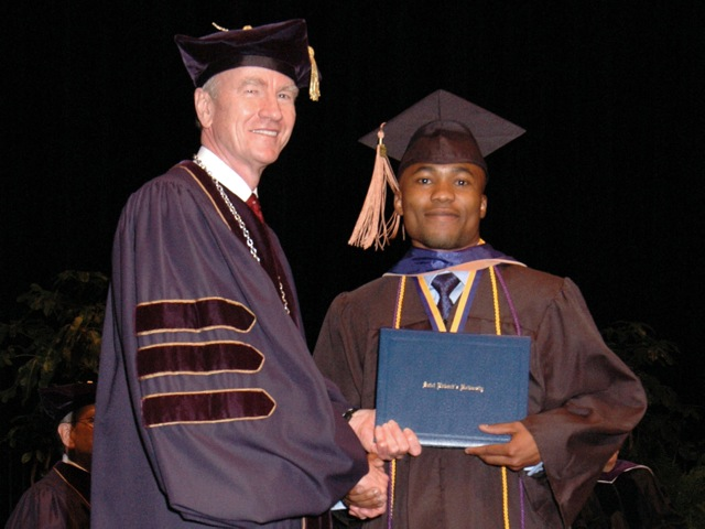 Dr. Martin with a student at graduation