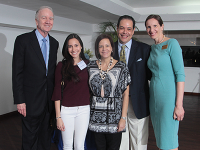 Aida Domingo with parents and St. Edward's faculty