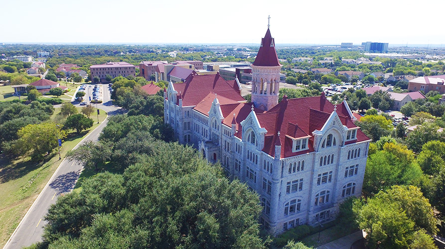 Aerial view of Main Building and the St. Edward's campus in Austin