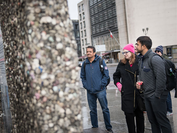 MBA student team pauses to view a section of the Berlin wall.