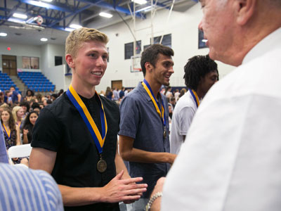Students receives his St. Edward's medallion at the Medallion Ceremony
