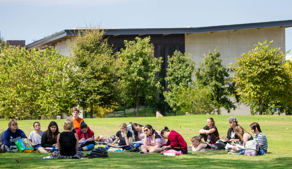 Undergrad students enjoy class outside