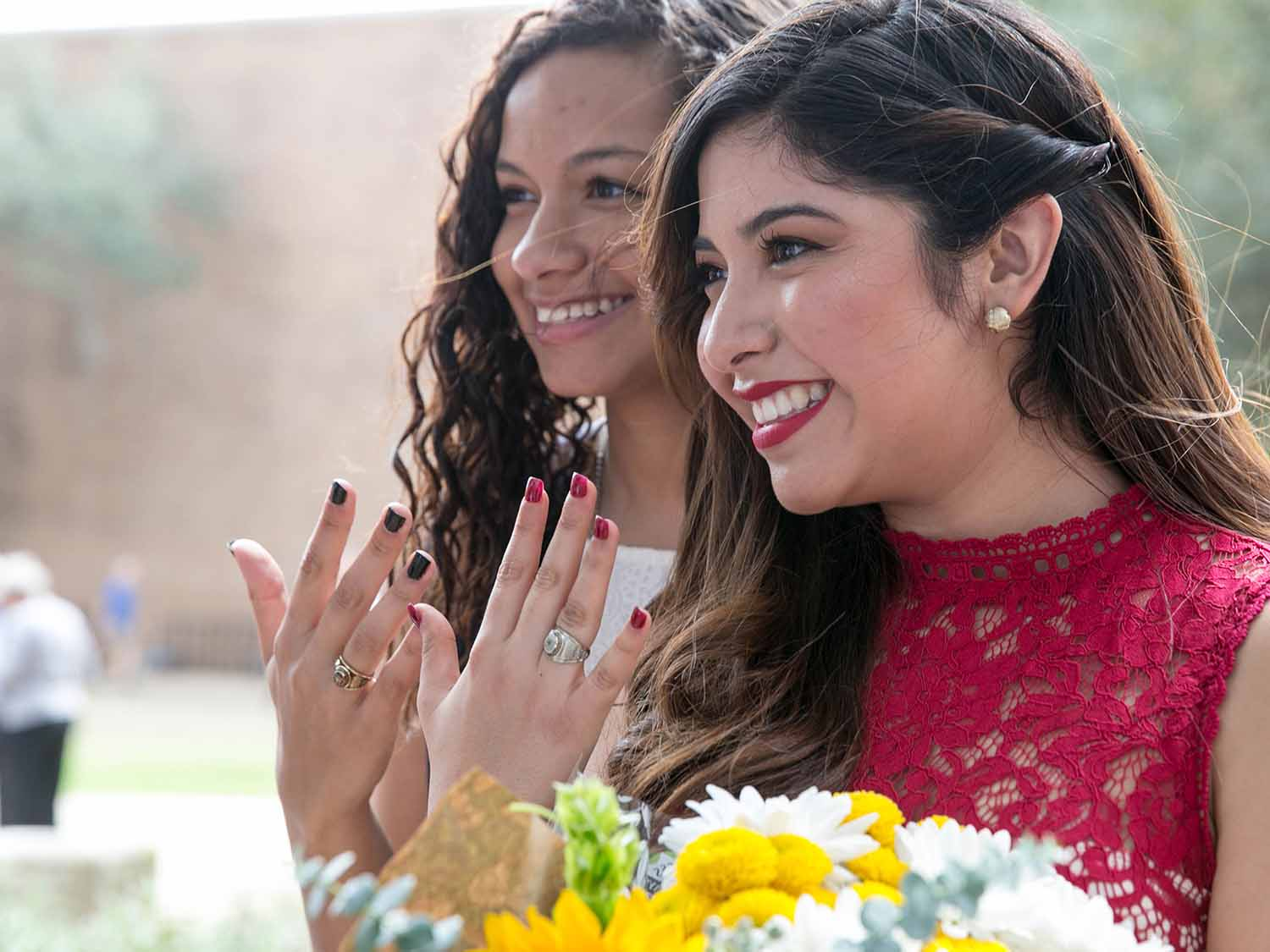 Students show their St. Edward's class rings at ring ceremony