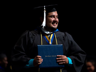 Student receiving his diploma