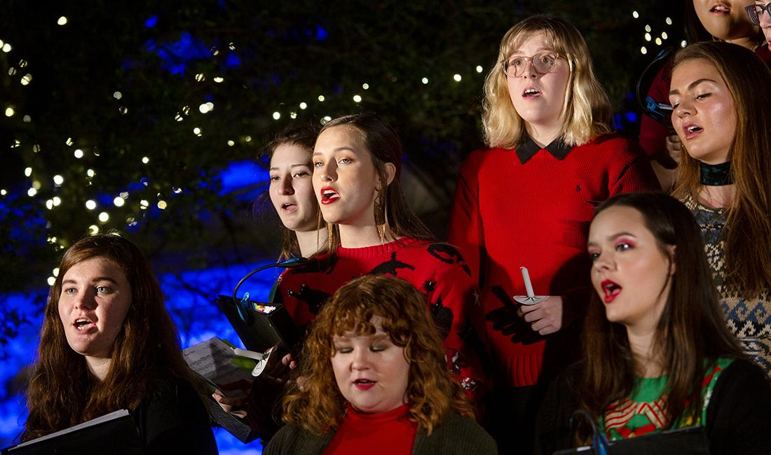 Students sing at the festival of lights