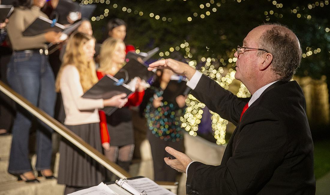 conducting the choir at festival of lights