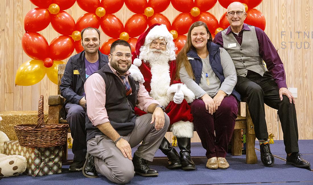 Members of the community pose with Santa Clause