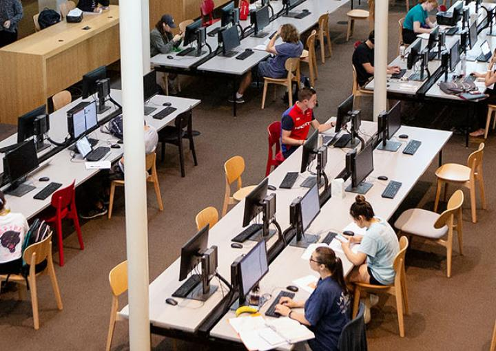 St. Edward's University students studying in Munday Library - mobile