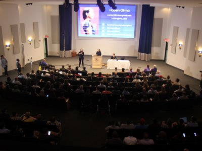 Keynote speaker Haben Girma on-stage in Jones Auditorium, seen from above.