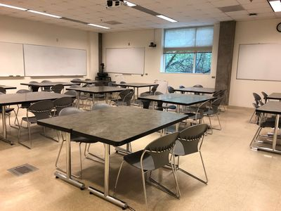JBWN 202 classroom before renovation with static, non-moveable tables and chairs.