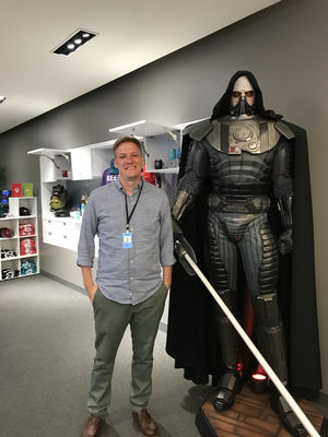 Simon poses next to an ominous EA game character.