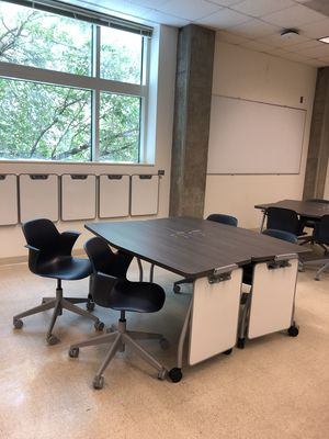 Table with four mobile seats and two personal whiteboards in the refurbished JBWN 202 classroom.