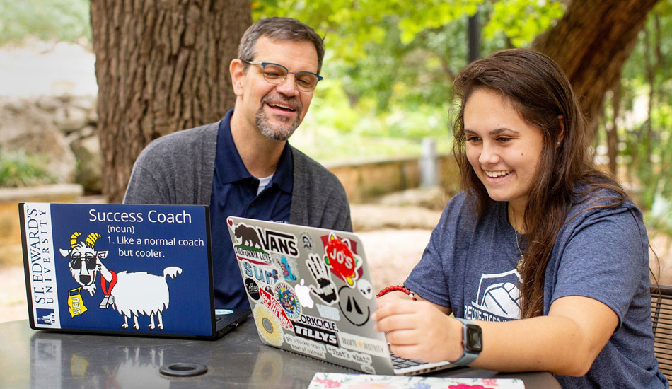 Student meets with success coach on campus
