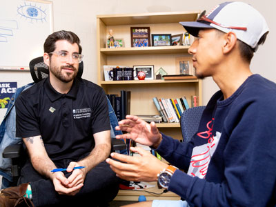 Success Coach talks with student