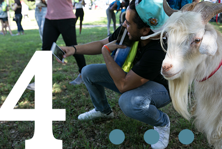 Student taking selfie with goat at Hillfest