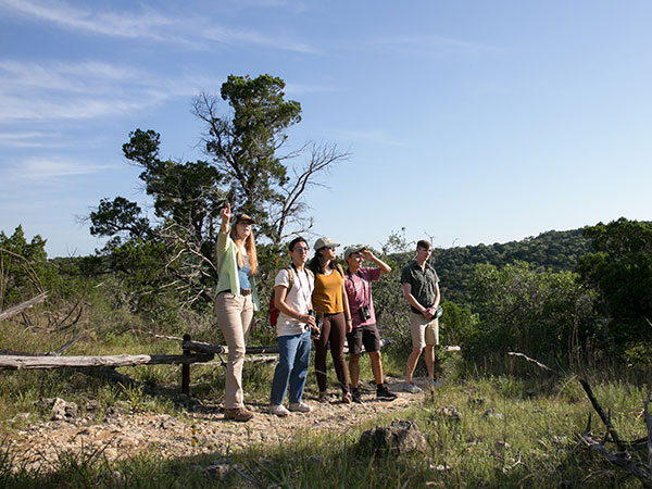 Group taking a guided hike at Wild Basin Nature Preserve